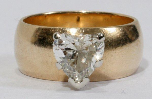 040021: 1.2CT HEART SHAPE DIAMOND 14KT YELLOW GOLD RING