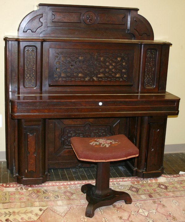 050001: B. SHONINGER CARVED MAHOGANY UPRIGHT PIANO