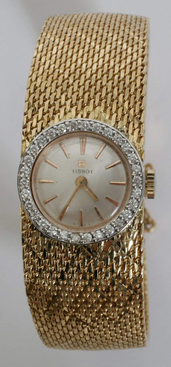 060007: DIAMOND LADY'S TISSOT SWISS 14KT GOLD WATCH