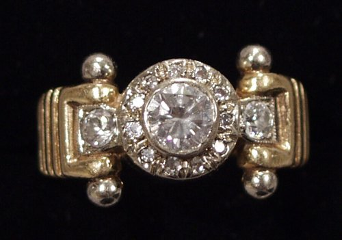 050011: GOLD & .55 CT DIAMOND RING