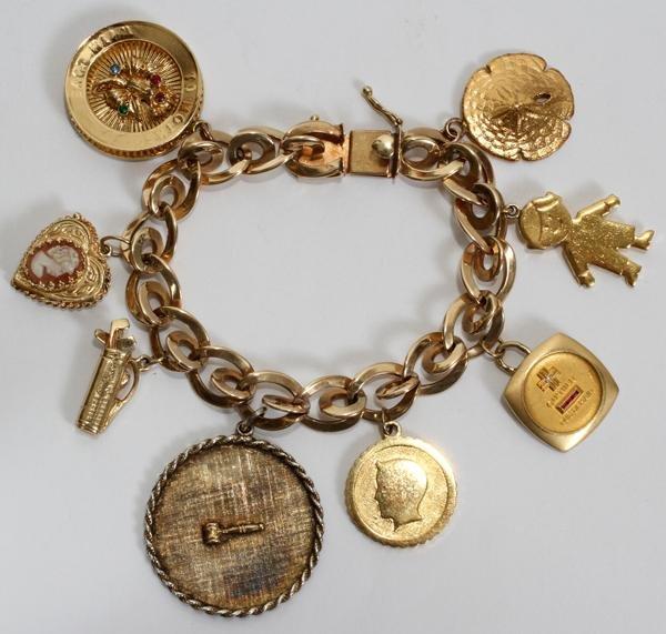 110044: LADY'S 14 KT. GOLD CHARM BRACELET
