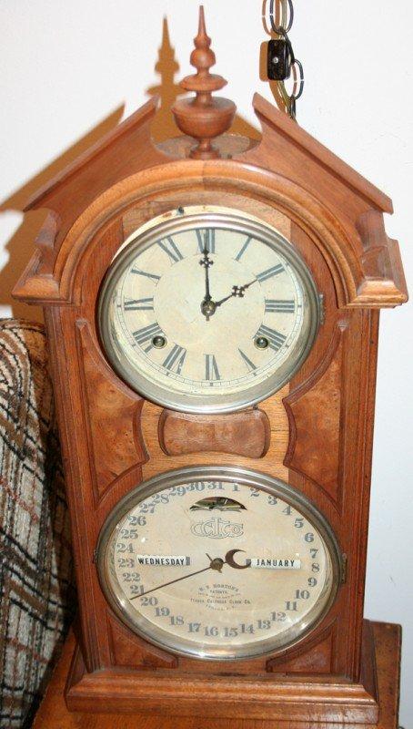 "040001: ITHACA WALNUT CALENDAR CLOCK, H 25"", W 12"""
