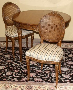LOUIS XV FRUITWOOD DINING TABLE AND CHAIRS,