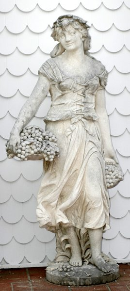 072119: CARVED LIMESTONE FIGURE OF A WOMAN W/ GRAPES