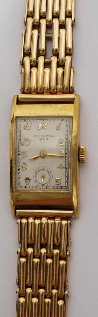 092069: PATEK PHILIPPE MAN'S YELLOW GOLD WRIST WATCH,