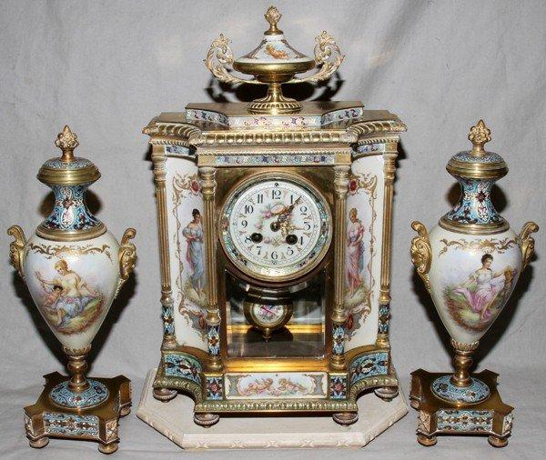 101002: SEVRES FRENCH PORCELAIN MANTEL CLOCK & URNS