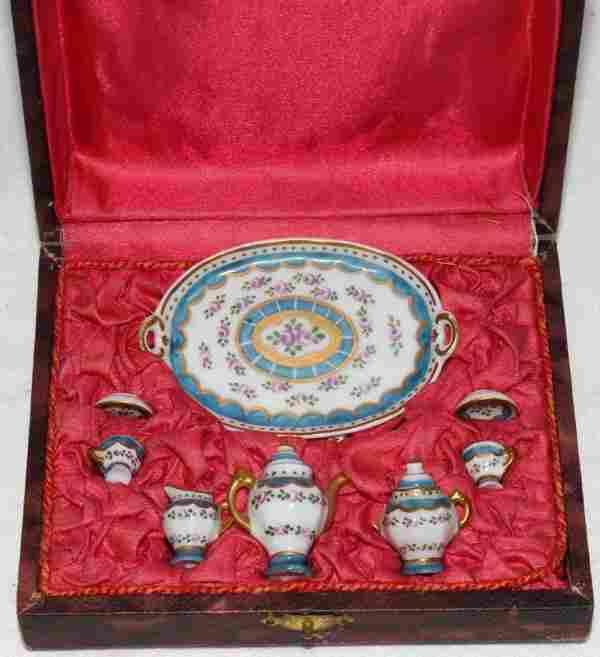 121332: LIMOGES PORCELAIN MINIATURE TEA SET, C. 1900