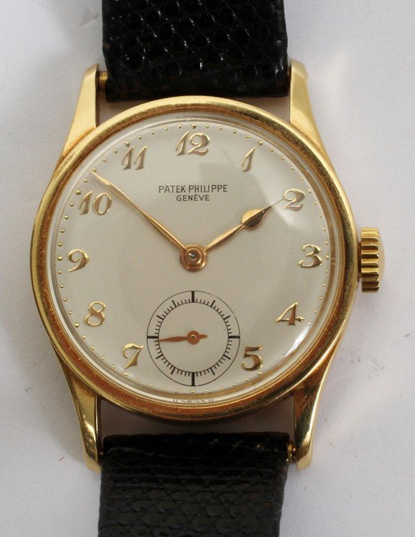 012398: PATEK PHILIPPE 18KT GOLD WATCH, W/REPLACED BAND