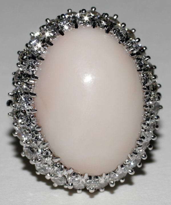 090999: CORAL & DIAMOND RING W/ WHITE GOLD SETTING