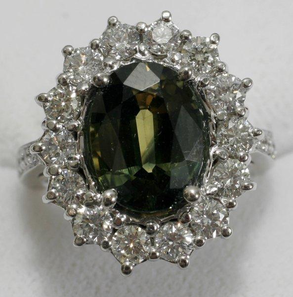 091006: WHITE GOLD, GREEN SAPPHIRE & DIAMOND RING