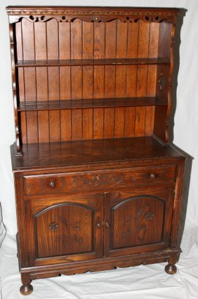 HENRY C. STEUL & SONS HAND CARVED OAK HUTCH,