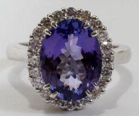 4.22CT TANZANITE & .62CT DIAMOND RING