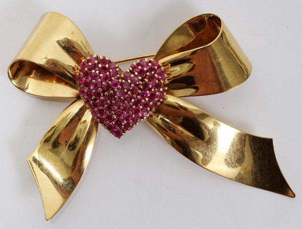 """080022: 14 KT YELLOW GOLD & RUBY BOW PENDANT, H 2 1/2"""""""