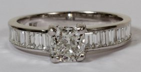 010023: 1.01CT DIAMOND RING & 1.40CT SIDE BAGUETTES