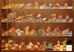 ESTEE LAUDER SOLID PERFUMES IN DISPLAY CABINET