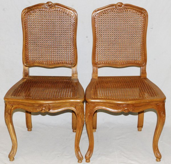FRENCH CARVED WALNUT AND CANE DINING CHAIRS, 24