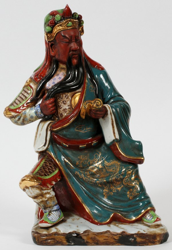 CHINESE PORCELAIN FIGURE SEATED WARRIOR
