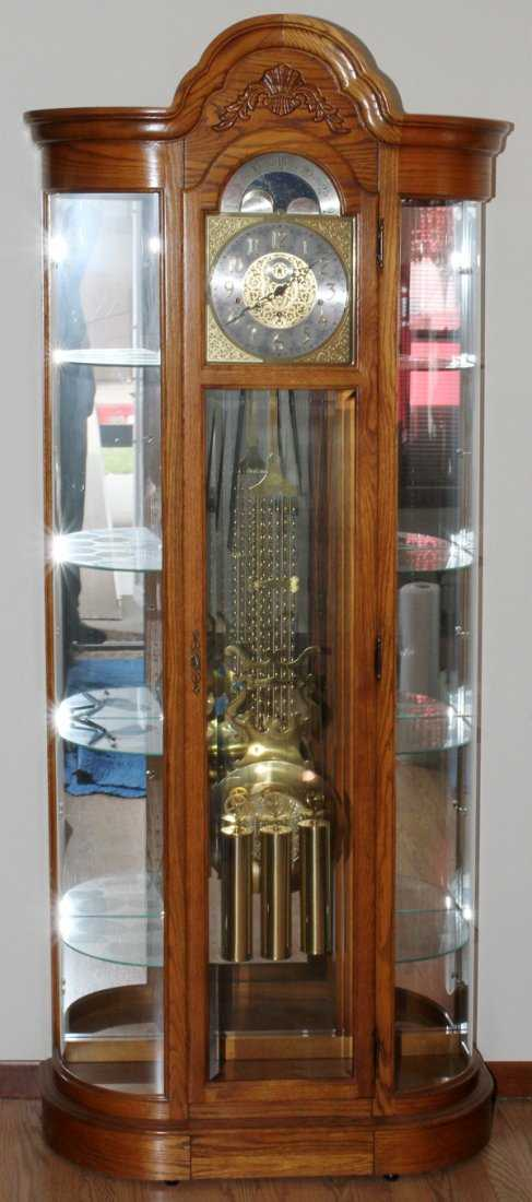 Howard Miller Oak Grandfather Clock Curio Cabinet