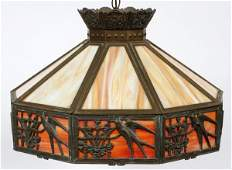 GILT METAL AND CARAMEL GLASS HANGING LAMP
