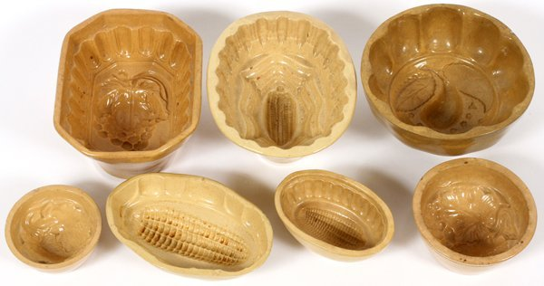 YELLOW WARE POTTERY CAKE MOLDS 7 PIECES