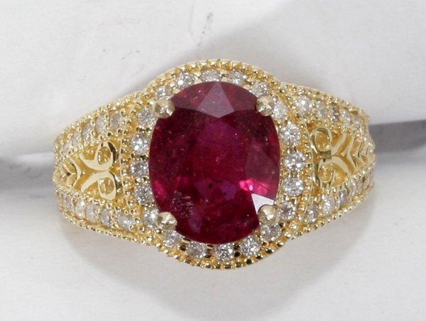 040009: 4CT RUBY, .6CT DIAMOND & GOLD FILIGREE RING