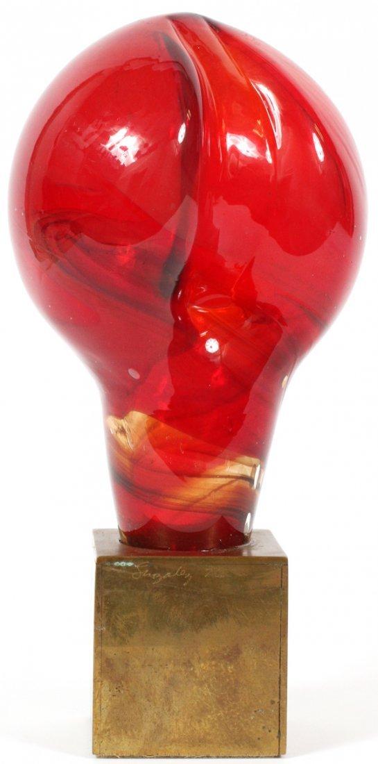 PAUL GONZALEZ RED GLASS ON BRASS BASE SCULPTURE