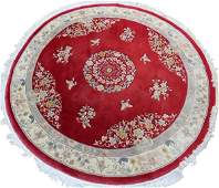CHINESE HAND WOVEN ROUND WOOL RUG LATE 20 TH C.
