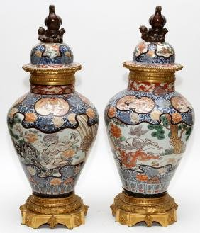 CHINESE PORCELAIN COVERED URNS W/ BRONZE MOUNTS