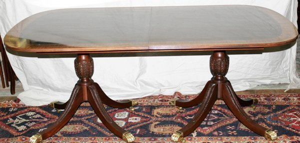 070004: MAHOGANY PEDESTAL TABLE W/ BRASS PAW FEET