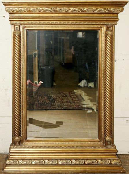 070006: EUROPEAN EMPIRE STYLE GILT WOOD BEVELED MIRROR
