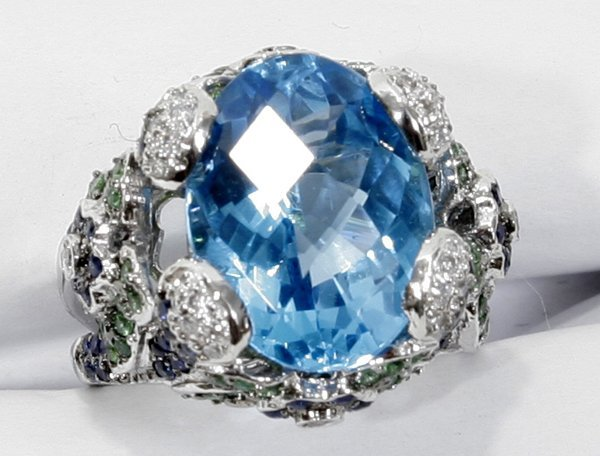 070015: GOLD, TOPAZ, SAPPHIRE, GARNET & DIAMOND RING