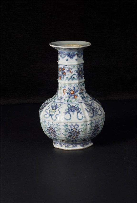 An octagonal doucai 'bajixiang' bottle vase, Qing