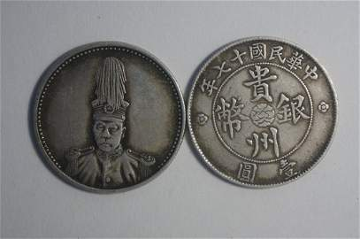 2 pieces of Chinese silver coin
