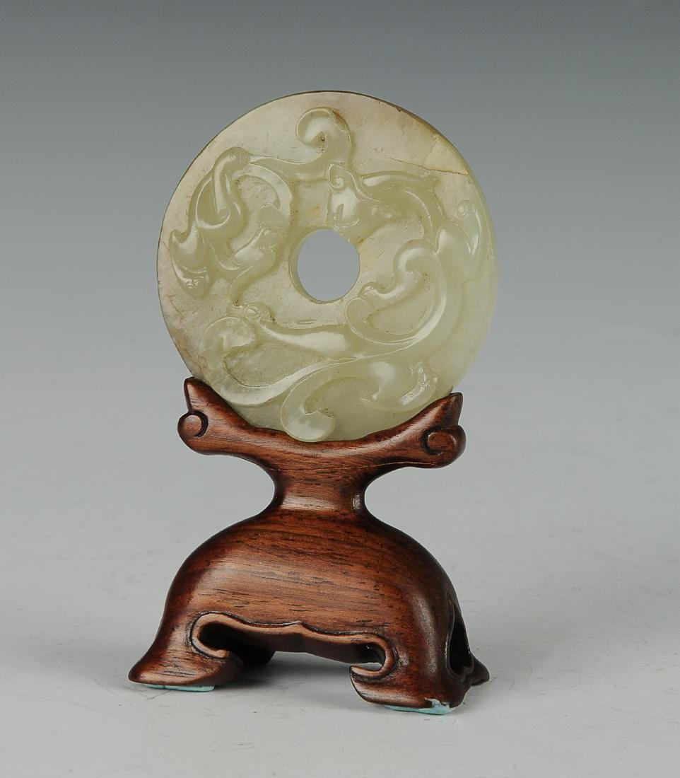 Carved Jade Bi with Wood Base, 18th - 19th Century