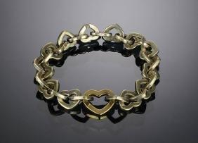A Tiffany & Co. 18K Gold & Sterling Heart Bracelet