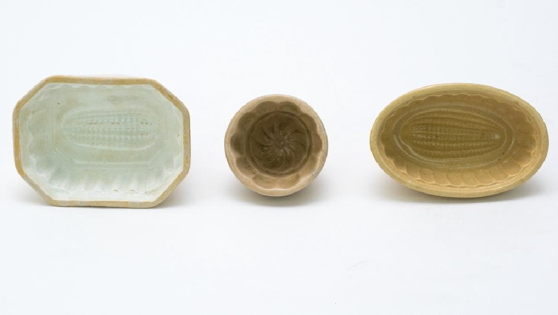 Three Yellow Ware Molds