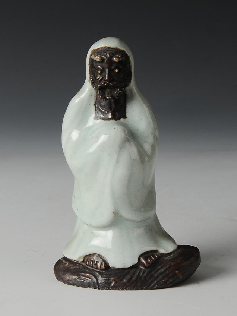 Chinese Shiwan Celadon Glaze Damo Statue, 19th C.