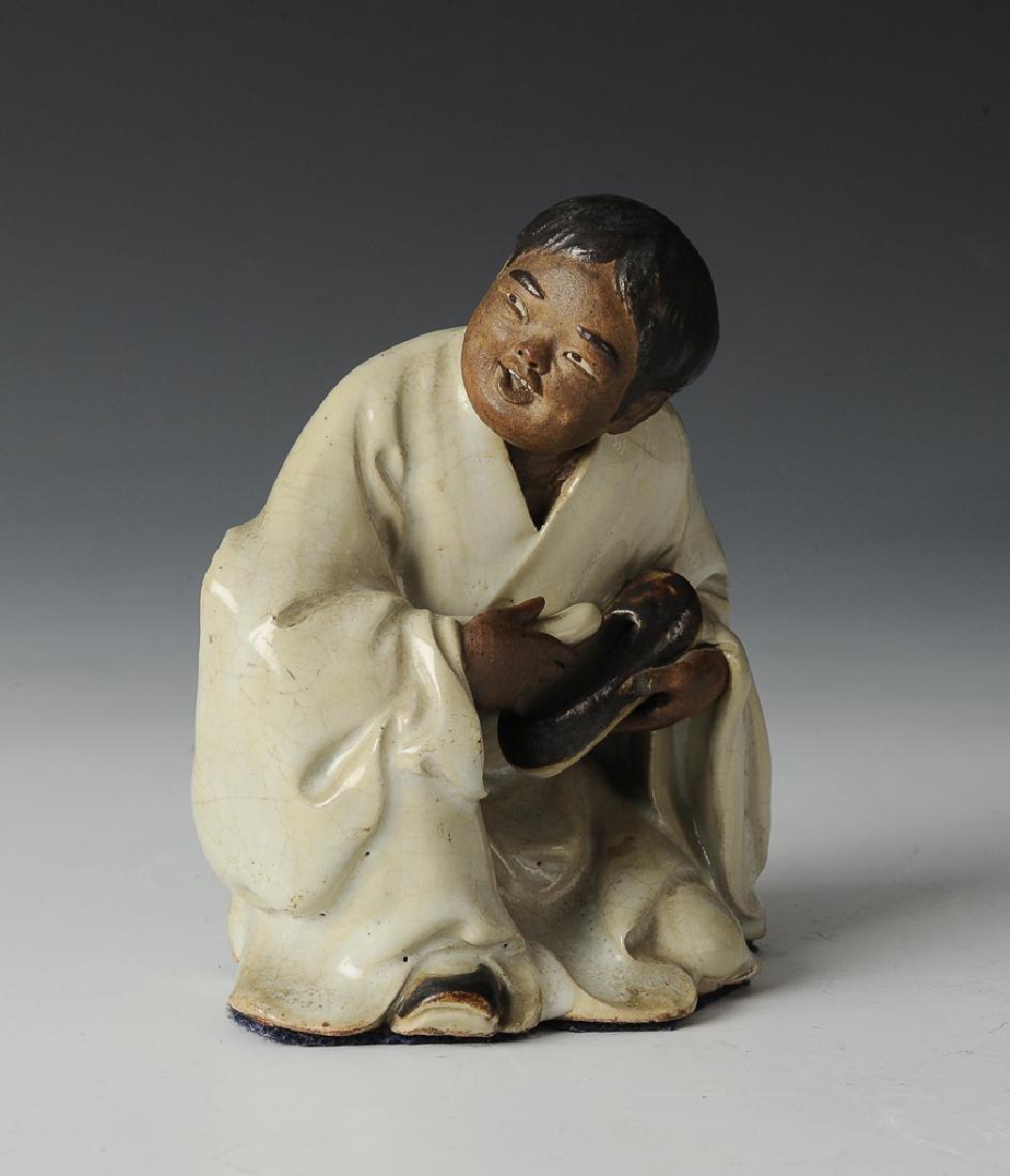 Shiwan Statue of Boy w/ Shoe, 18th-19th Century