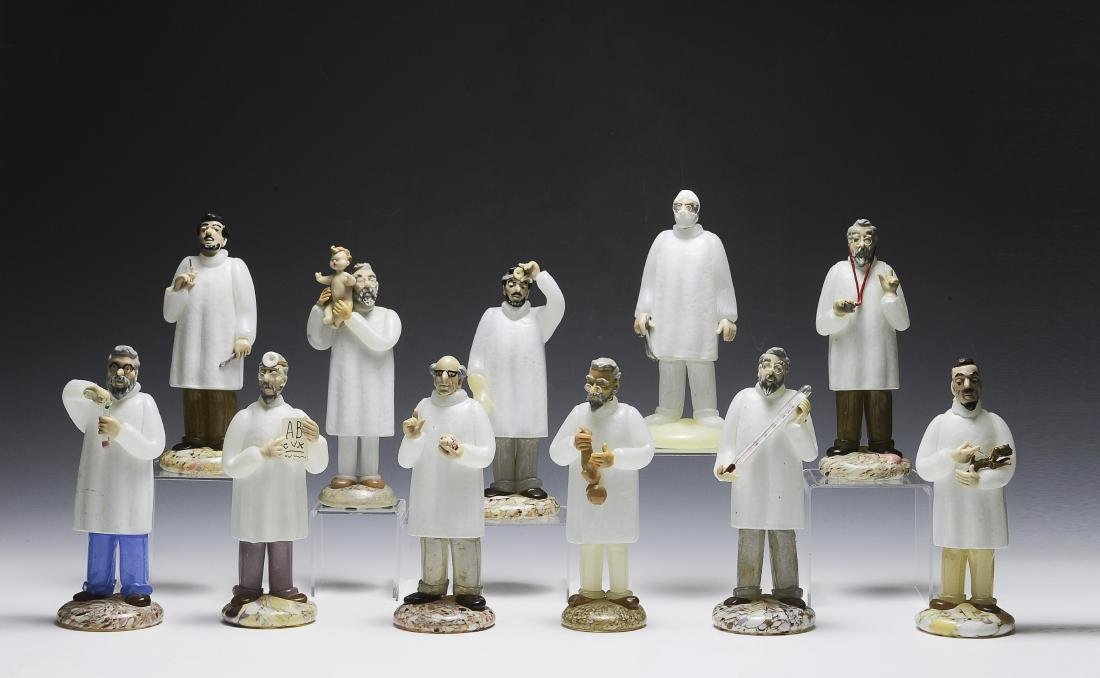 Eleven Czech Glass Doctor Figurines