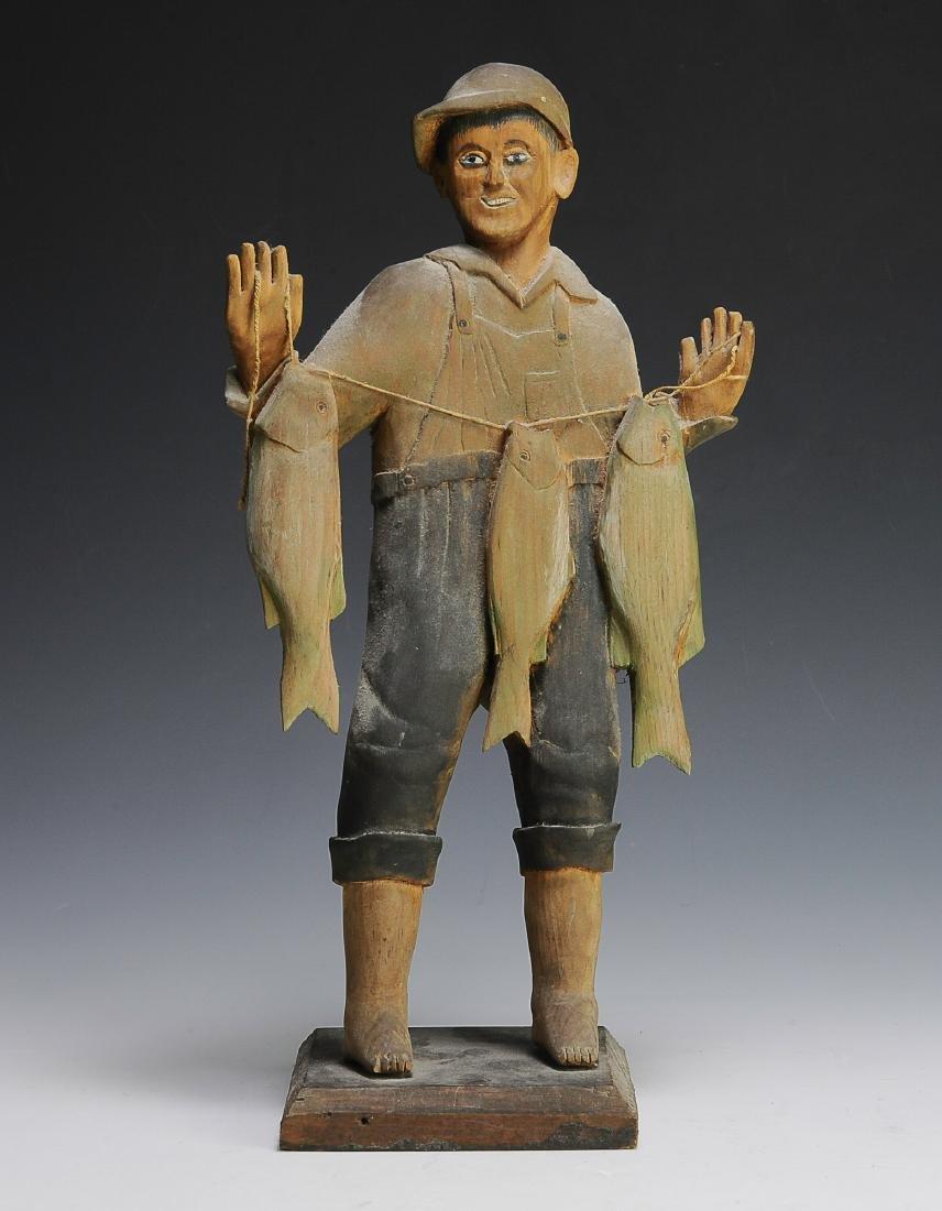 A Fine Iowa Folk Art Carving of a Fisherman