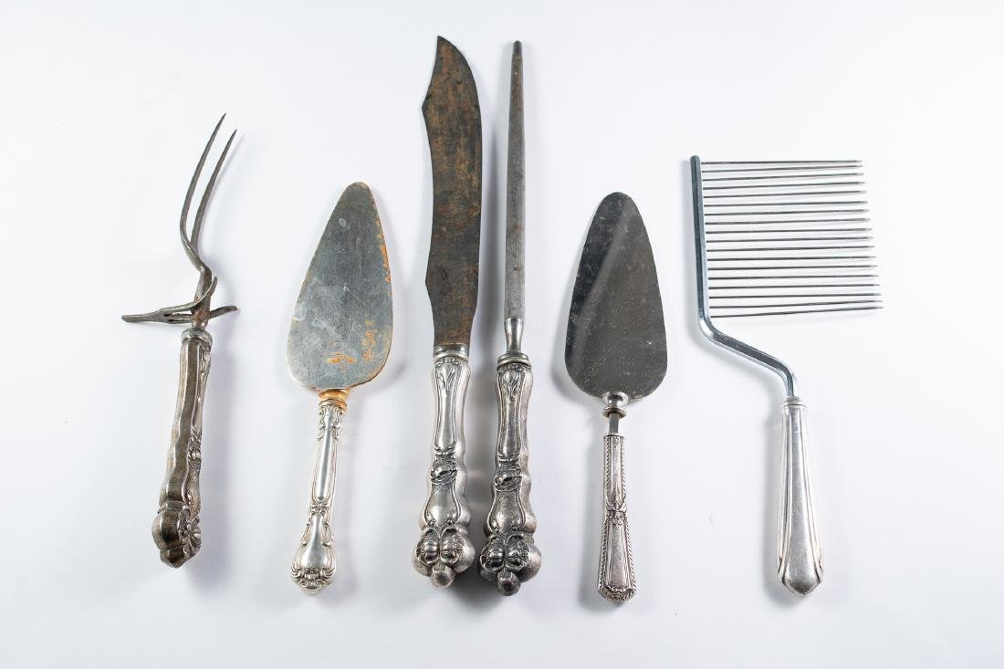 Six pieces of Sterling Handled Tableware