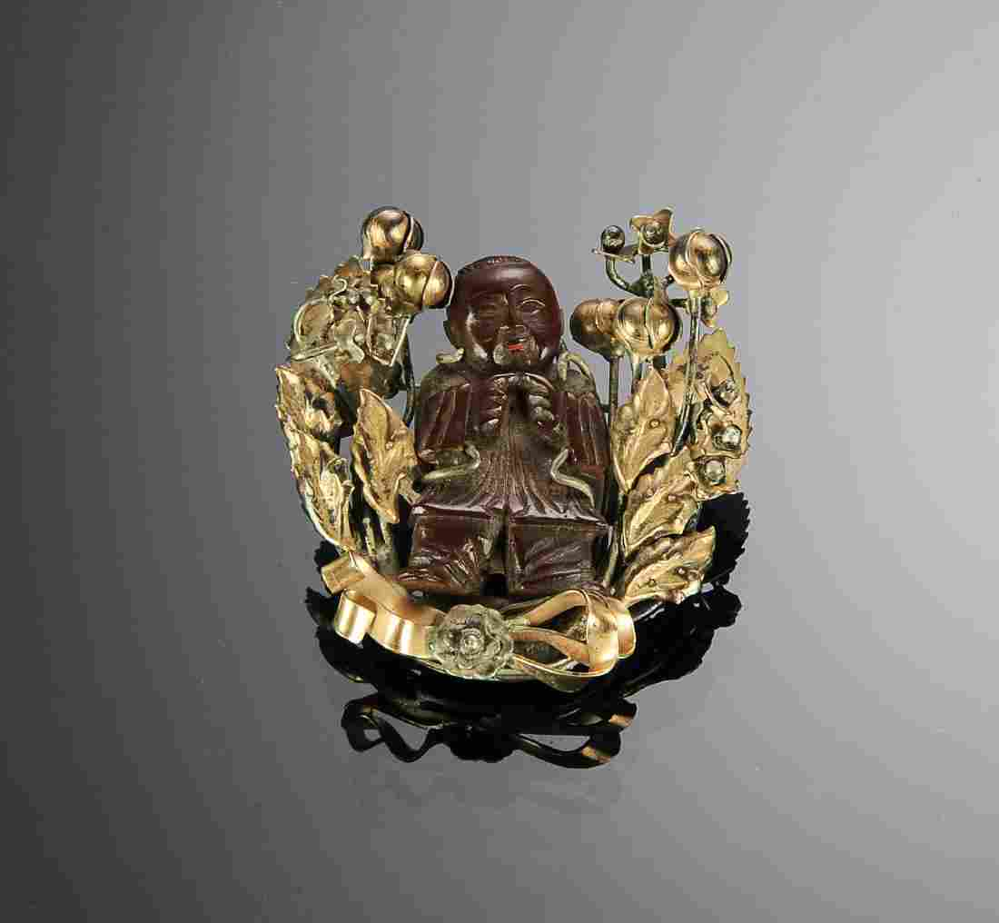 A Gilt Silver Pin with Carved Chinese Figure