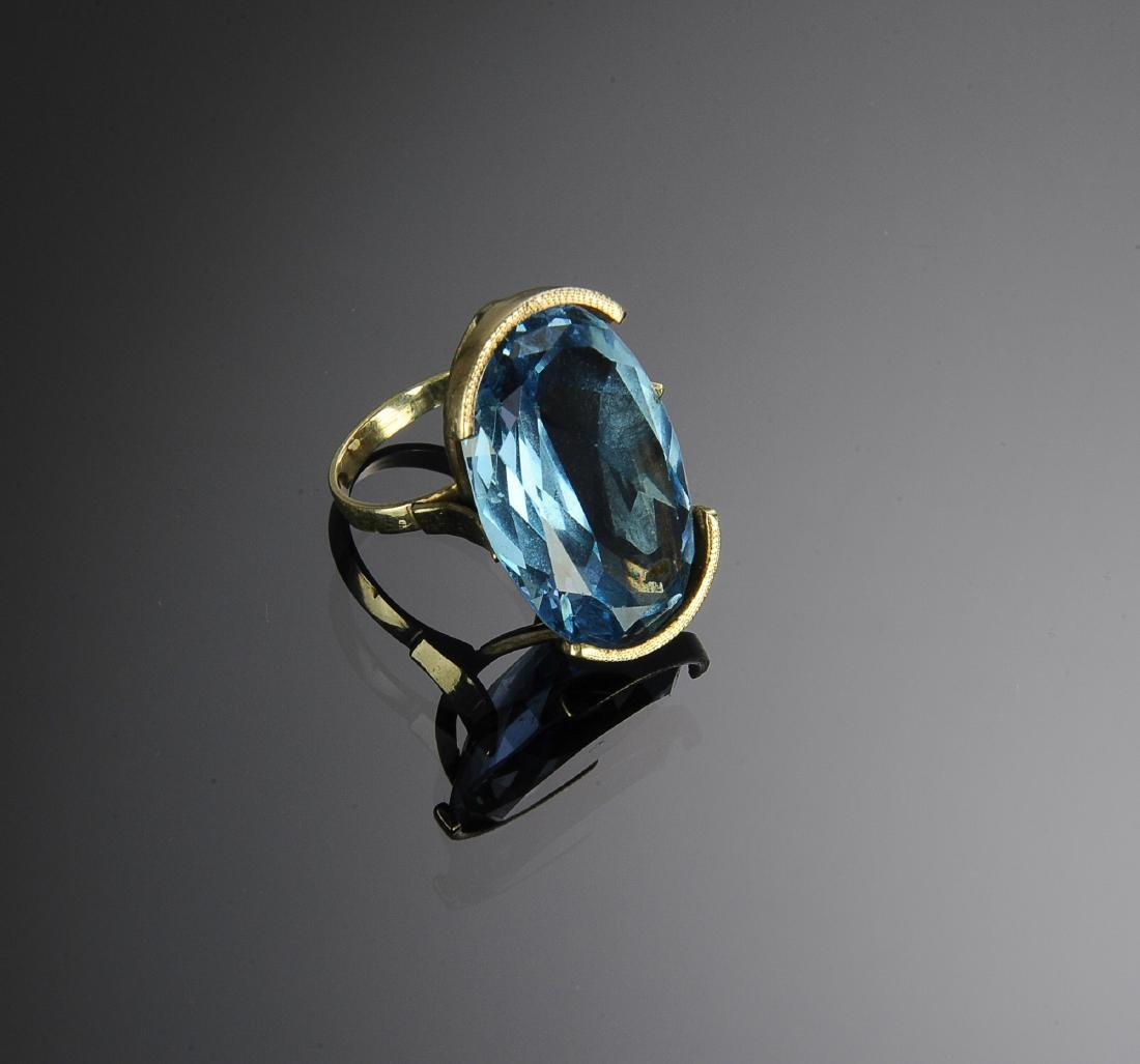 A 14K Gold Ring with 39 Carat Blue Topaz