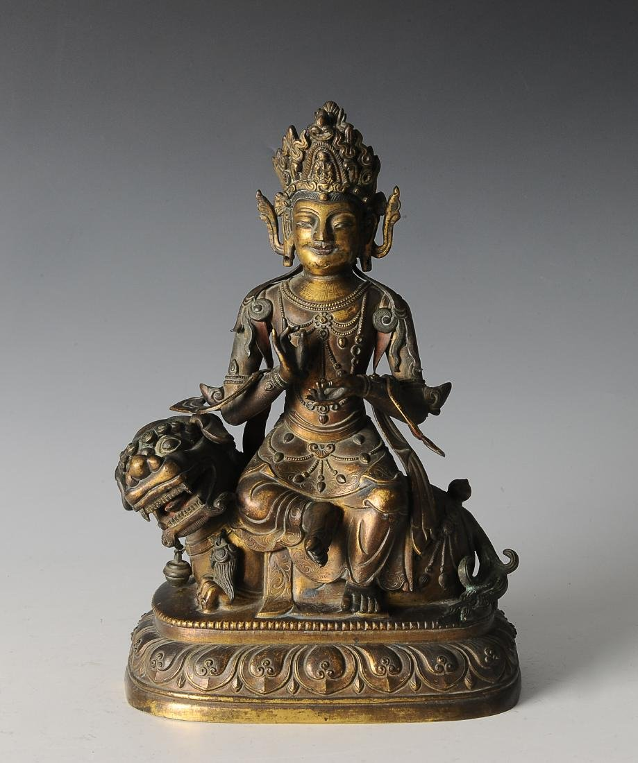 Gilt Bronze Buddha Riding Qilin, Ming Dynasty