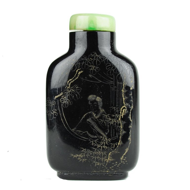 A dark glass snuff bottle	 19th century
