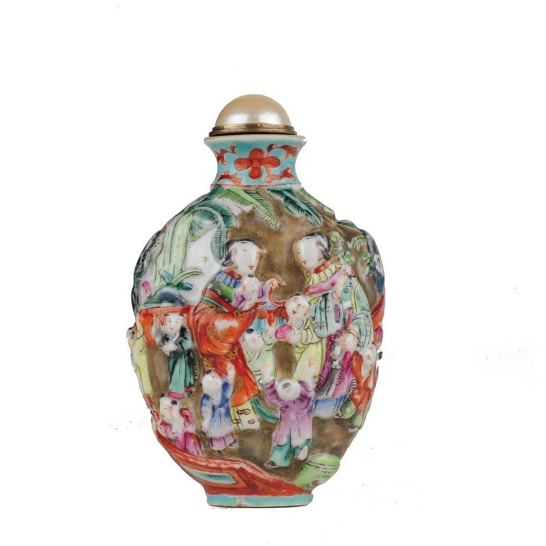 A molded porcelain snuff bottle	 19th century