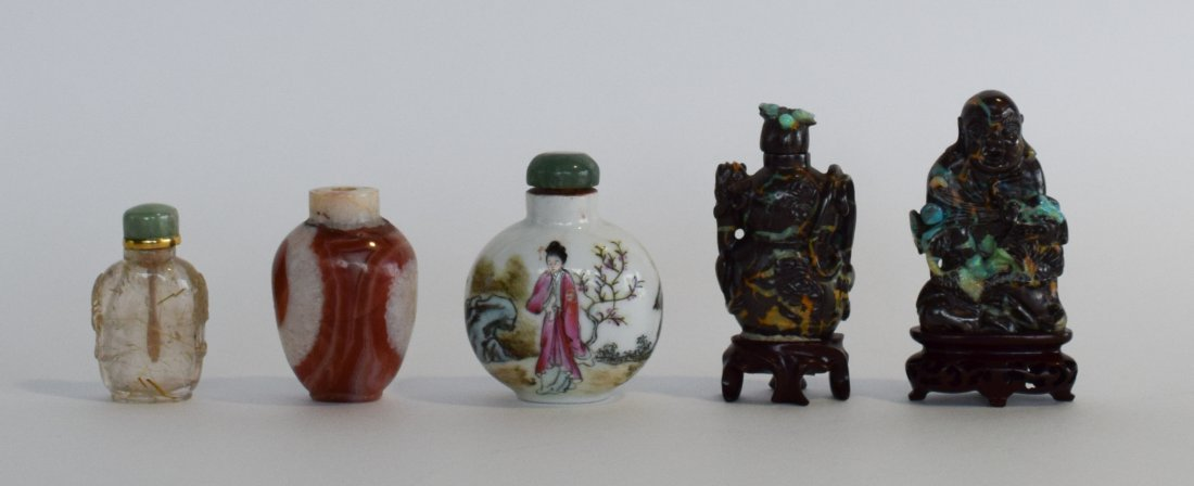 Four Snuff Bottles and a Figure