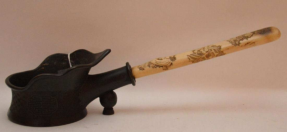 Antique Bronze Chinese Pot with carved bone handle.