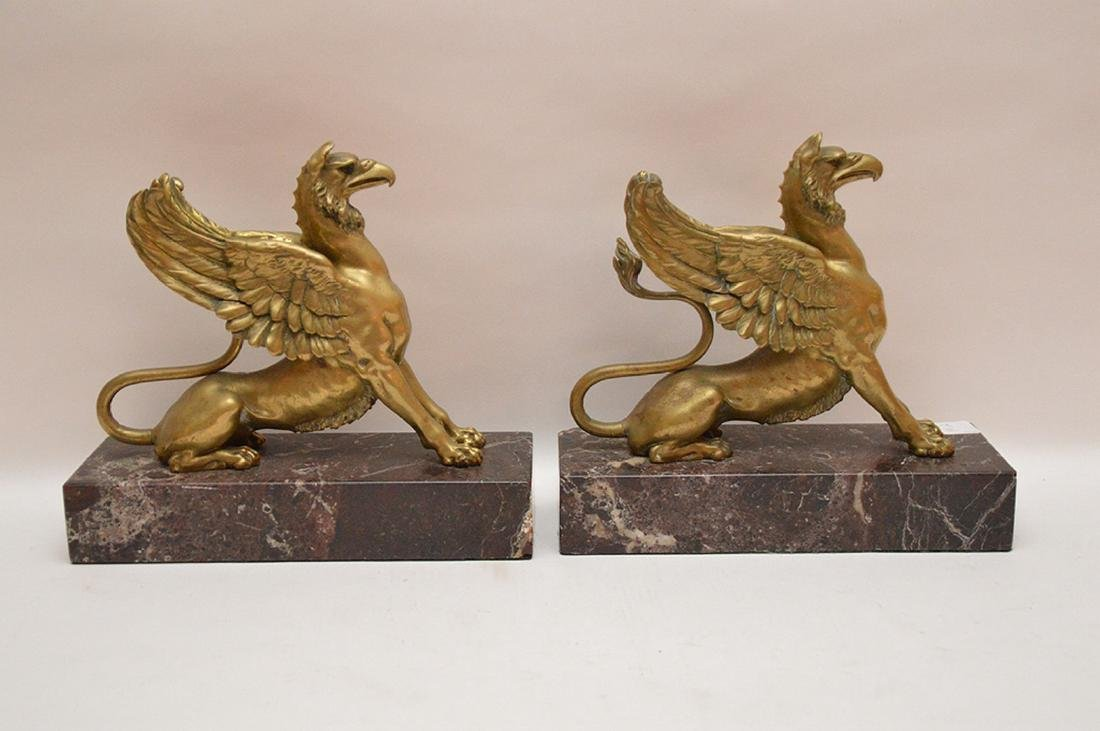 Pair Gilt Bronze Griffins on red marble bases.  Ht. 10 - 5