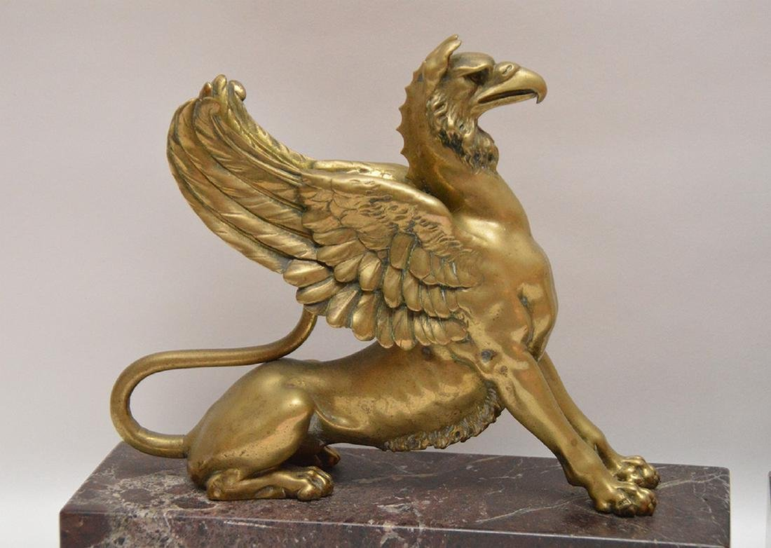 Pair Gilt Bronze Griffins on red marble bases.  Ht. 10 - 6